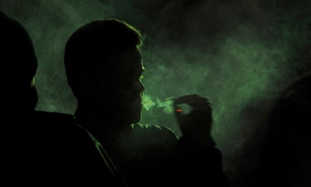 Denver man smoking joint at Snoop Lion concert