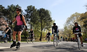 Cyclists, runners and skaters exercise around Central Park.