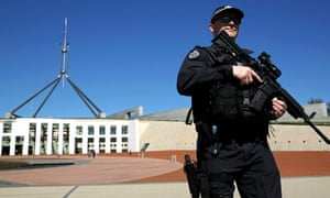 An Australian federal police officer patrols in front of Parliament House