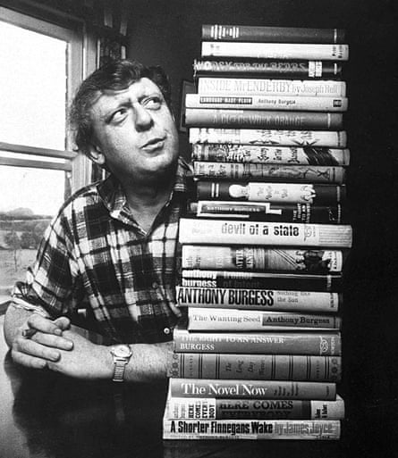 Manchester-born author Anthony Burgess with his books.