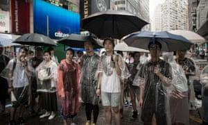 Hong Kong pro-democracy demonstrators hold umbrellas.