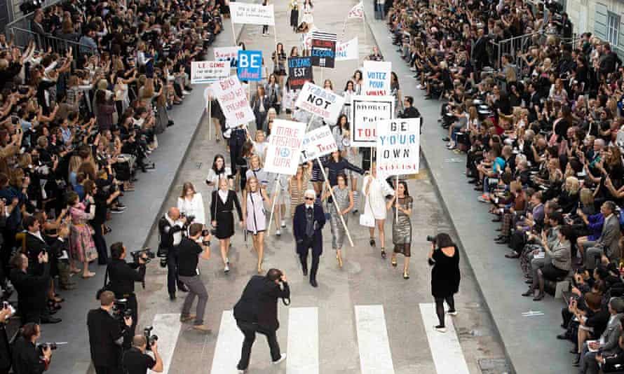 Karl Lagerfeld with models in Paris