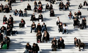 Office workers enjoy sunny lunch hour on steps of Grande Arche in La Defence, Paris, France