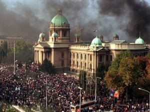 Smoke rises from the Yugoslav federal parliament, Thursday, October 5, 2000, in Belgrade. Angry crowds gathered in front of the parliament while columns of protesters streamed into the capital for a mass rally intended as the final push against embattled President Slobodan Milosevic. Police used teargas to prevent opposition supporters from entering the parliament building. Serbia (AP PHOTO / Zeljko Safar)   YUGOSLAVIA OUT   COMMERCIAL ONLINE OUT