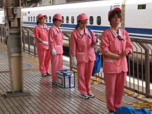 The 'Angels': A train cleaning team waiting to swoop on an incoming train.