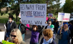 Protesters against proposed changes to the national history curriculum march outside the Jefferson County school board meeting.