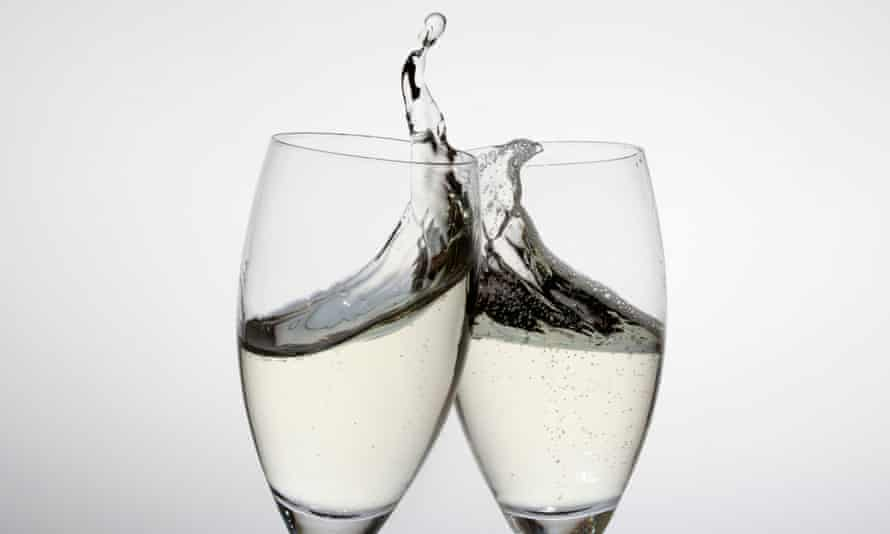 Toasting with two glasses of champagne.