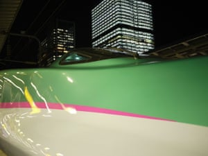 'The driver's cab of one of the newer types of Shinkansen waiting at Tokyo station, looking more like a spaceship than a train.'