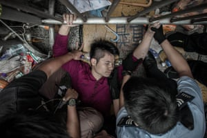 Policemen try to get a man to let go of a fence guarded by pro-democracy demonstrators in an occupied area of Hong Kong. By the end of the week violent clashes occurred as supporters of Chinese rule stormed tents and tore down banners of the pro-democracy activists