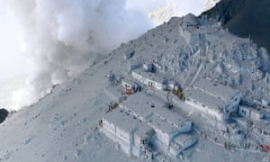 More than 40 people were confirmed dead after the Mount Ontake volcano erupted sending a huge cloud of ash and rock tumbling down its slopes, packed with hikers. Here, Japan self-defense force soldiers and firefighters conduct rescue operations at mountain lodges, covered with volcanic ash