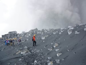 Here, climbers descend Mount Ontake after the worst fatal eruption in postwar Japan