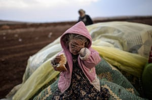 Bulent Kilic continued his strong reportage from the border between Syria and Turkey. Here, a Syrian Kurdish woman waits with her daughter at the southeastern town of Suruc. Kurdish fighters backed by US-led air strikes were locked in fierce fighting to prevent the besieged border town of Ain al-Arab from falling to the Islamic State group fighters