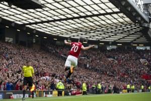Manchester United's Robin van Persie celebrates at Old Trafford after scoring against West Ham United