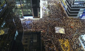 Throngs of Pro-democracy protestors gather in Mongkok, as thin blue police lines attempt to keep student activists and their single remaining tent separated from a vocal and violent backlash by local residents and pro-Beijing supporters.