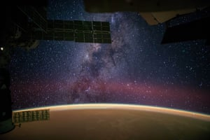 In a photograph provided by NASA, the Milky Way is captured by astronaut Reid Wiseman from the International Space Station. Wiseman wrote: 'The Milky Way steals the show from Sahara sands that make the Earth glow orange.'