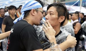 A face-off between pro-democracy protestors and a vocal mob of local residents Occupy Central movement protest, Hong Kong, China.