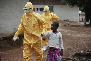 Nine-year-old Nowa Paye is taken to an ambulance after showing signs of the infection in the village of Freeman Reserve. Three members of District 13 ambulance service travelled to the village to pick up six suspected Ebola sufferers that had been quarantined by villagers