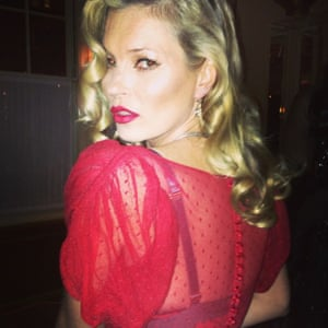 Kate Moss followed the dress code for Mario's birthday party: red, black and white, 1940's Havana.