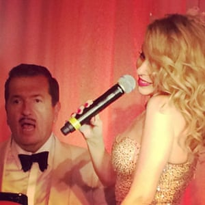 It's Mario Testino's 60th birthday party - and guess who just popped out of the cake to sing for the moustachioed Mario....?