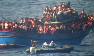 A crowded boat of immigrants during a rescue operations off the coast of Sicily