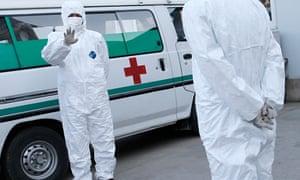 North Korean healthcare workers wear protective suits Ebola