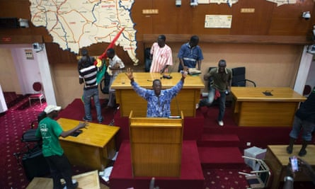 Anti-government protesters take over the parliament building in Ouagadougou, capital of Burkina Faso, October 30, 2014.