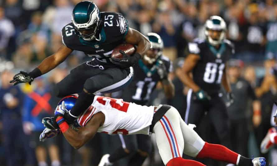 Philadelphia Eagles running back LeSean McCoy  is hit by New York Giants strong safety Antrel Rolle. nfl