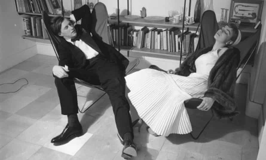 The designer and restaurateur Terence Conran, founder of Habitat, and his wife, Shirley, the journalist and author, relaxing at home in hammock chairs (1955).