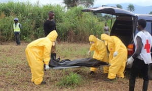 Health workers carry the body of an Ebola virus victim in the Waterloo district of Freetown.