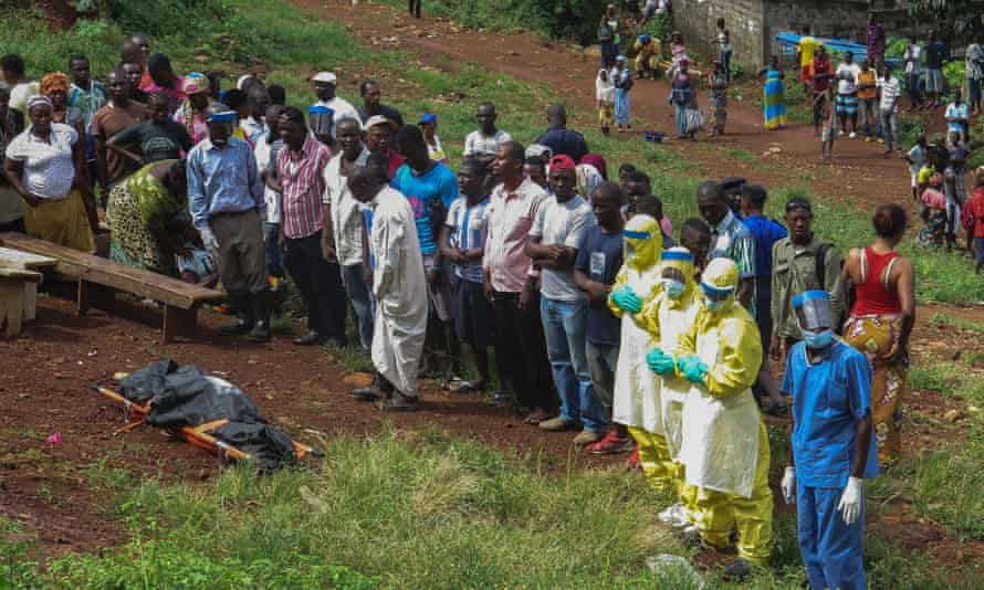 Prayers are made for a victim of Ebola in Freetown.
