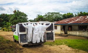 Health workers transport the body of a person suspected to have died of Ebola in Port Loko, on the outskirts of Freetown.