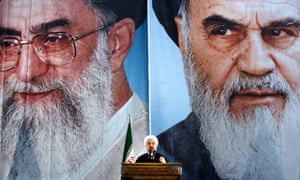 President Hassan Rouhani delivers a speech under portraits of Ayatollah Ali Khamenei (left) and Iran's founder of the Islamic Republic, Ayatollah Ruhollah Khomeini.