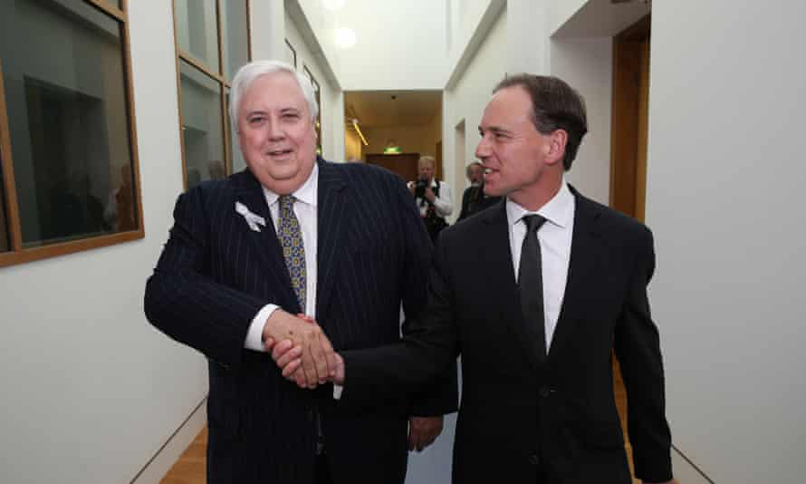 Palmer United Party leader and coal miner Clive Palmer shakes the hand of Environment Minister Greg Hunt after striking a deal to pass the Government's Direct Action policy through Australia's Senate.