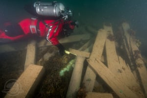 Filippo Ronca explores cannon and timbers from the wreck of the Erebus.