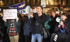 Demonstrators outside at event in Glasgow attended by Labour party leader Ed Miliband