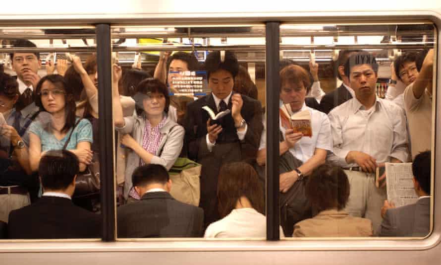 Commuters on the subway at Shinjuku Station Tokyo