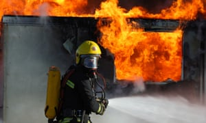 Firefighter outside a burning building