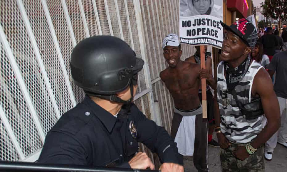 Protesters confront police following George Zimmerman's acquittal for the killing of Trayvon Martin.