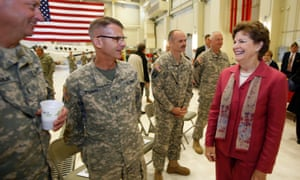 Sen. Jeanne Shaheen, D-N.H., meets with New Hampshire Army National Guard members during a deployment ceremony for troops of Operational Support Airlift  Detachment 18 Wednesday,  Oct. 29, 2014 in Concord, N.H.