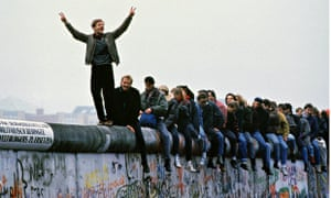 West Germans Celebrate The Unification Of Berlin Atop The Berlin Wall During The Collaps