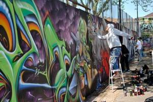 Graffiti artists painting Dean Lane skatepark in Bristol.