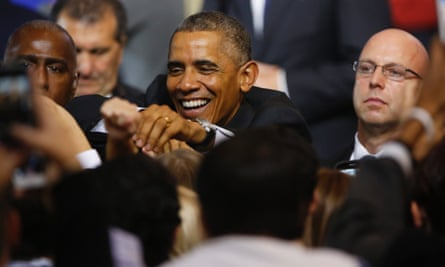 Barack Obama shakes hands with supporters after giving a pre-election speech in Rhode Island on 31 October.
