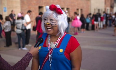 Carolyn Molina, of Riverside, California, laughs while talking to a reporter at the Hello Kitty Con, the first-ever Hello Kitty fan convention in Los Angeles.
