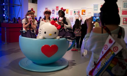 Hello Kitty fans pose for photos in a giant tea cup at the Hello Kitty Con.