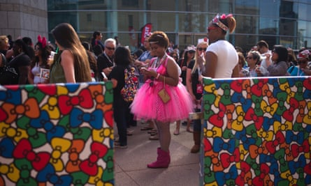 Fans wait in line to attend the Hello Kitty Con.