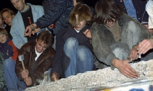 West Berliners chip away at the Berlin Wall