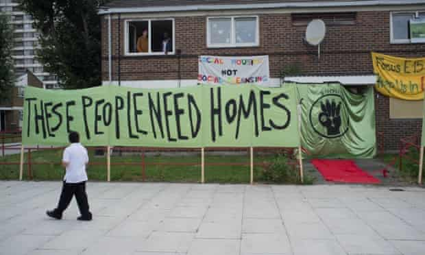 Banners outside occupied flats as members of the group E15 Mothers stage a sit-in at the Carpenters estate in east London.