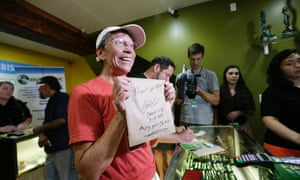 Deb Greene, the first customer at the Cannabis City marijuana shop in Seattle, Washington in July, after the state legalised marijuana for recreational use.