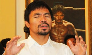 Pacquiao prays during the dedication ceremony of his youngest child at his house in General Santos City.