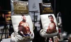 Boxing gloves featuring Floyd Mayweather Jr and Manny Pacquiao are seen during the Box Fan Expo at the Las Vegas Convention Center last month.